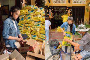 Hình ảnh đẹp của Hoa hậu Tiểu Vy ăn mặc giản dị, vác bao gạo tặng đồng hương